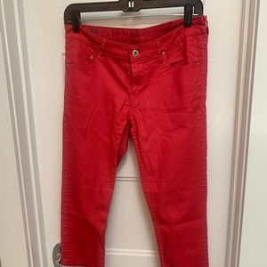 Red ankle jeans w/ zipper accents